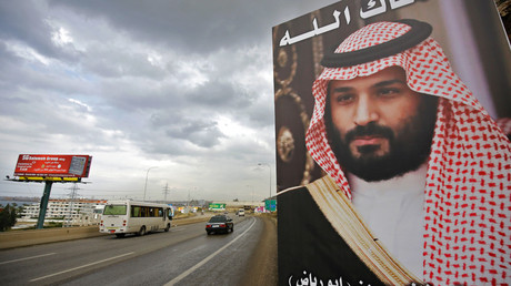 "A poster of Saudi Arabia's Crown Prince Mohammed bin Salman with a phrase reading in Arabic, "" God protect you"" is seen on a highway in the northern Lebanese port city of Tripoli on November 9, 2017 © Ibrahim Chalhoub"