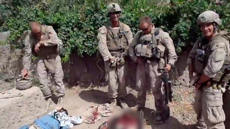 A still image taken January 11, 2012 from a YouTube video shows what US Marines urinating on the bodies of dead Taliban fighters in Afghanistan © Reuters