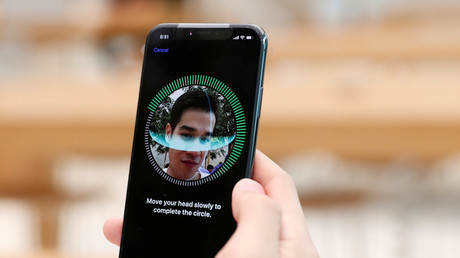 A customer sets up his iPhone X Face ID during its launch at the Apple store in Singapore © Edgar Su