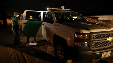 FILE PHOTO: U.S. border patrol agents detain a man after he was spotted crossing illegally into the United States along the Mexican border near Calexico, California, U.S. © Mike Blake