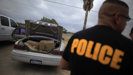 FILE PHOTO: A car filled with bales of marijuana is seen at a police station in La Grulla, Texas © Eric Thayer