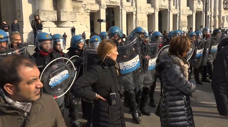 Students face off with police in Milan at rally against education reforms