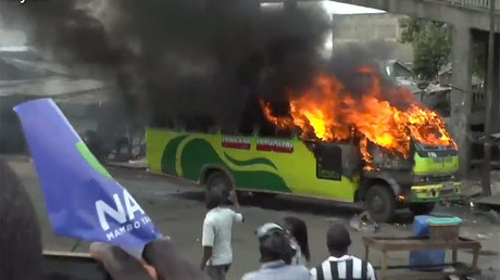 Bus set ablaze, tear gas fired as Kenya opposition activists clash with police