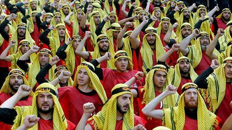 Supporters of Lebanon's Hezbollah party parade to mark the last day of Ashura ceremony in Beirut, Lebanon October 1, 2017. © Aziz Taher