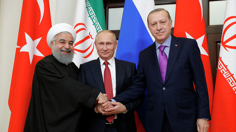 Putin meets Erdogan & Rouhani for Syria talks in Sochi