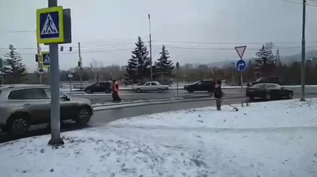 'This is Siberia!' Utility provider workers in Krasnoyarsk mow lawns ahead of winter