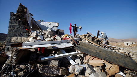 FILE PHOTO: People inspect damages at the site of a Saudi-led air strike which struck a house where mourners had gathered for a funeral north of Yemen's capital Sanaa. © Mohamed al-Sayaghi