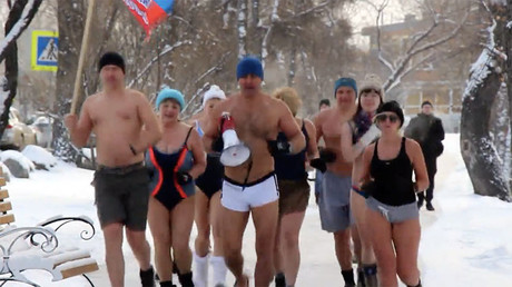 Breaking the ice! Russian chill-seeker dives into freezing waters of Lake Baikal (VIDEO)