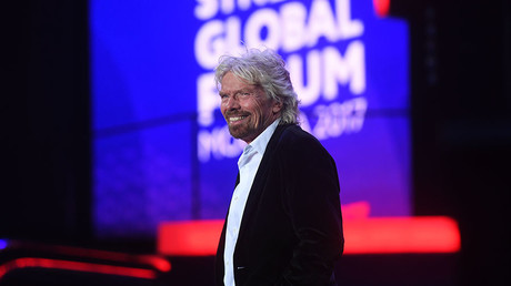 Sir Richard Branson speaks during the Synergy Global Forum at the Olimpiisky Sports Complex. © Kirill Kallinikov