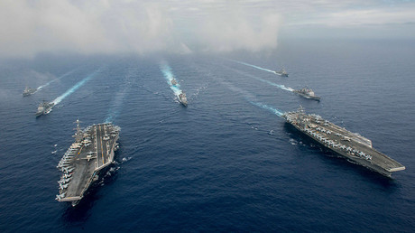 The Nimitz-class aircraft carriers USS John C. Stennis (CVN 74), and USS Ronald Reagan (CVN 76) (R) conduct dual aircraft carrier strike group operations © Jake Greenberg