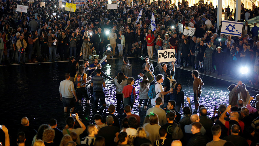 Image result for 20,000 join Tel Aviv 'March of Shame' to protest bill aimed at protecting Netanyahu