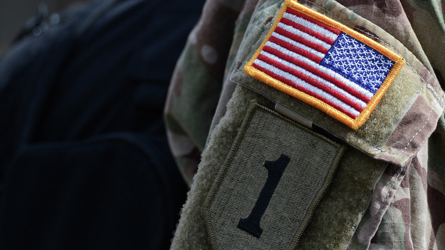 An arm patch on the uniform of a NATO's multinational battalion serviceman