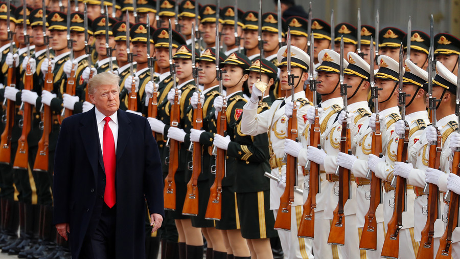China warns of 'pressure and challenges' after Trump report