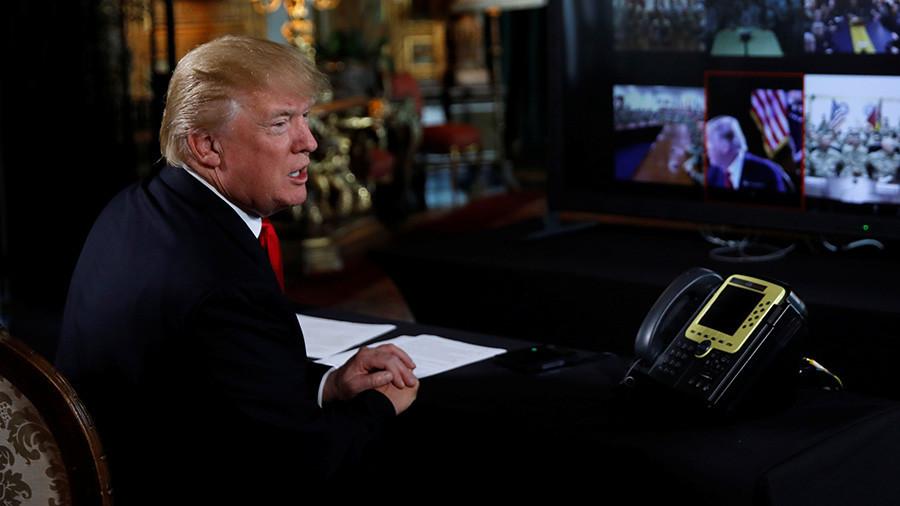 Trump continues attack on FBI, calls Clinton dossier 'garbage'