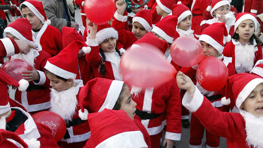 Little Santas flock onto Aleppo streets at Christmas, 1 year after liberation (PHOTOS)