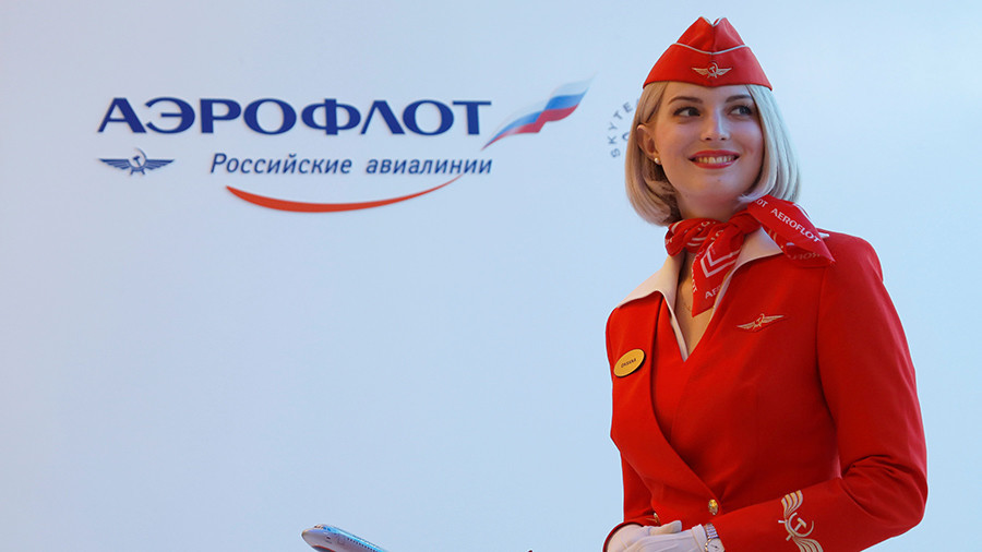 Putin backs Aeroflot plan to carry Russian football fans for less than $1 during World Cup