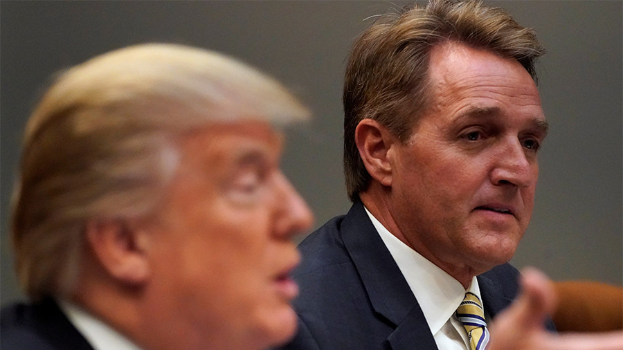 Trump foe Flake rejects president's attacks on 'sick' & 'rigged' US system