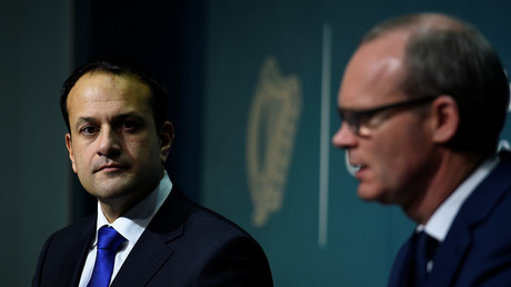 Prime Minister (Taoisaech) of Ireland Leo Varadkar looks on as Deputy Prime Minister (Tanaiste) Simon Coveney speaks during a press conference at Government buildings in Dublin, Ireland, December 4, 2017.  © Clodagh Kilcoyne