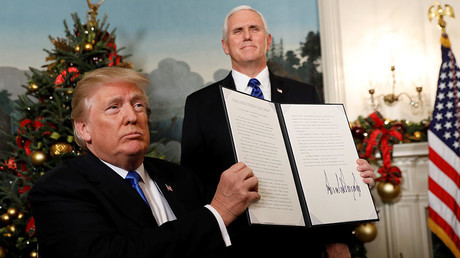 US President Donald Trump holds up the proclamation that the United States recognizes Jerusalem as the capital of Israel, December 6, 2017 © Kevin Lamarque
