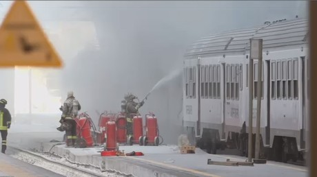 Fire tears through passenger train at Milan Central station in Italy