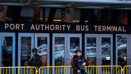 Police officers stand guard outside the New York Port Authority Bus Terminal © Lucas Jackson
