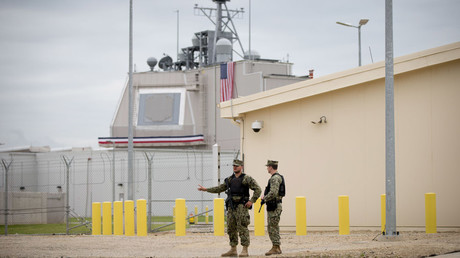 Two US soldiers standing outside the base for the Nato protective shield in Deveselu, Romania, 12 May 2016. The Aegis system, developed by the US Navy, is stationed in Deveselu © KAY NIETFELD