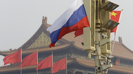 Russian and Chinese national flags © Jason Lee