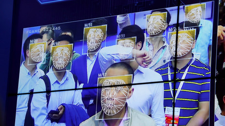 Visitors experience facial recognition technology at Face++ booth during the China Public Security Expo © Bobby Yip