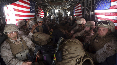 FILE PHOTO: U.S. Marines are seen on board a helicopter at Kandahar air base © Omar Sobhani