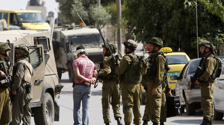 Israeli soldiers arrest a Palestinian man during a military operation in the West Bank city of Ramallah May 30, 2011. © Mohamad Torokman
