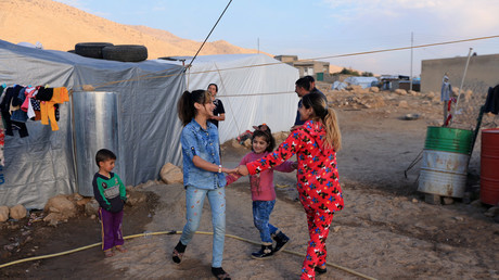 Yazidi girls Rosa, 13, Suhayla, 7, and Bushra, 12, who were reunited with their family after being enslaved by Islamic State militants, play at Sharya Camp in Dohuk, Iraq December 18, 2017 © Ari Jalal