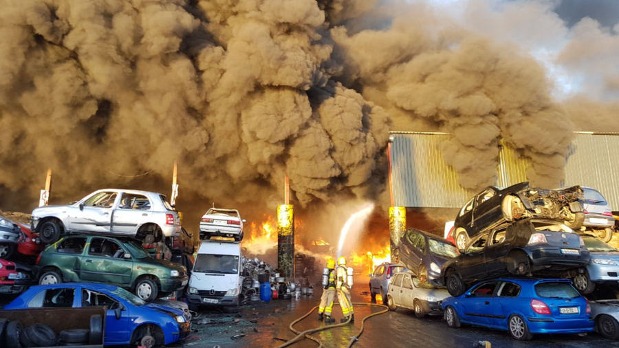 Fire crews battle massive blaze at scrap metal facility