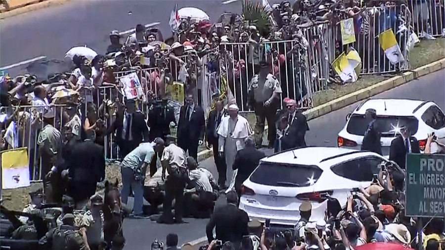 Popemobile grinds to a halt as Pontiff aids fallen police woman
