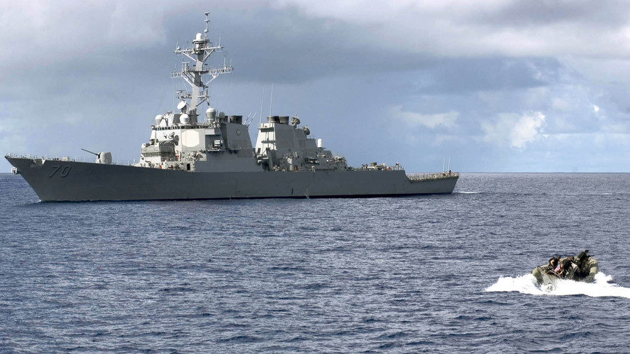 China says USA  trespassed its waters with warship