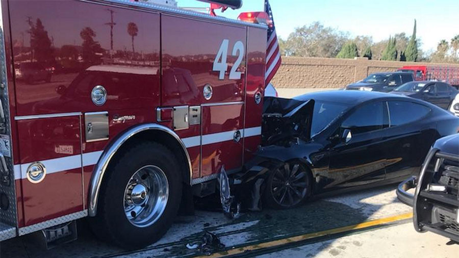 Tesla Car On Autopilot Smashes Into Parked Fire Truck