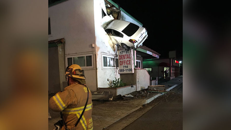 Speeding car takes flight, plows into 2nd floor of office building (PHOTOS)
