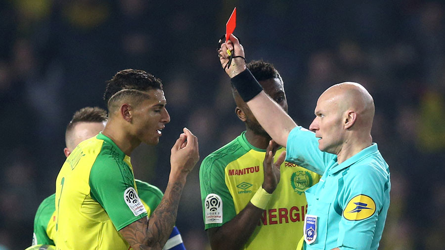 Ban for French football referee who kicked out at player before sending him off