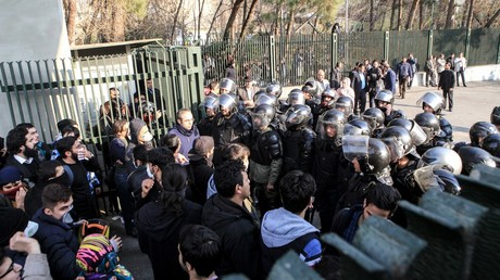 Iranian students scuffle with police during a demonstration in Tehran on December 30, 2017