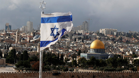 FILE PHOTO: An Israeli flag is seen near the Dome of the Rock, located in Jerusalem's Old City © Ammar Awad