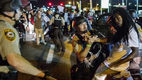 St Louis County police officers hold an anti-police demonstrator in Ferguson, Missouri August 10, 2015. © Lucas Jackson
