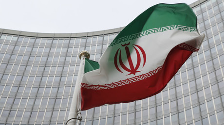 FILE PHOTO: An Iranian flag in front of the International Atomic Energy Agency (IAEA) headquarters in Vienna, Austria. © Leonhard Foeger