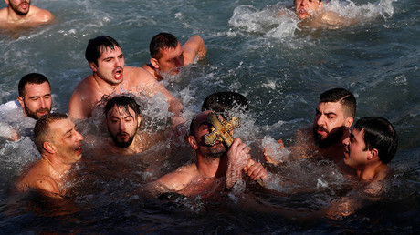 Orthodox Christians mark Epiphany with traditional cross dive in Istanbul