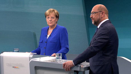 German Chancellor Angela Merkel of the Christian Democratic Union (CDU) and her challenger Germany's Social Democratic Party SPD candidate for chancellor Martin Schulz © Reuters