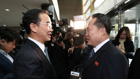 Head of the North Korean delegation Ri Son Gwon shakes hands with his South Korean counterpart Cho Myoung-gyon before their meeting at the truce village of Panmunjom in the demilitarised zone separating the two Koreas, South Korea, January 9, 2018. © Yonhap