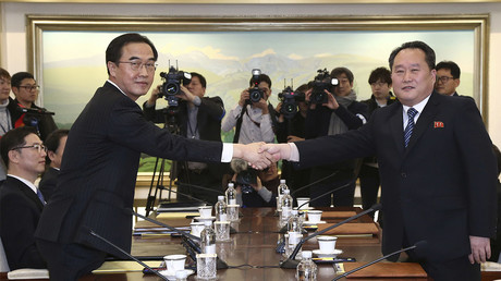 North & South Korea meet for rare talks, agree to reopen military hotline