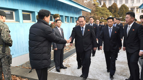 Head of North Korean delegation, Ri Son Gwon, is greeted by a South Korean official as he crosses a concrete border to attend their meeting at the truce village of Panmunjom in the demilitarised zone separating the two Koreas, January 9, 2018. © Korea Pool