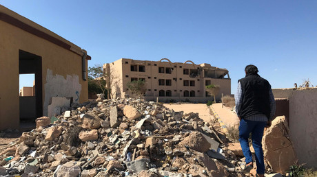 A Libyan man walks towards a hotel damaged during the NATO-backed campaign in 2011, in the city of Bani Walid, Libya October 29, 2017. © Ulf Laessing
