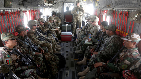 U.S. troops and Afghan National Army (ANA) soldiers are seen onboard a helicopter in Uruzgan province, Afghanistan July 7, 2017.  © Omar Sobhani