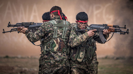 Fighters of the Kurdish People's Protection Units (YPG). © Rodi Said