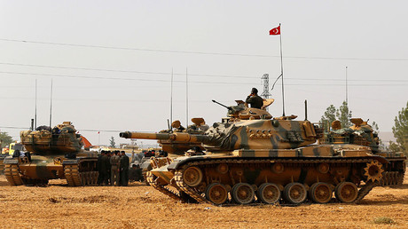 FILE PHOTO: Turkish army tanks and military personal are stationed in Karkamis on the Turkish-Syrian border in the southeastern Gaziantep province, Turkey. © Umit Bektas